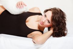 Sexy girl lazy woman with pillow on bed in bedroom Stock Image