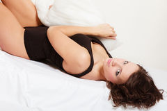 Sexy girl lazy woman with pillow on bed in bedroom Royalty Free Stock Image