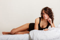 Sexy girl lazy woman in underwear lying on the bed Royalty Free Stock Photos