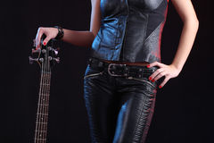 Sexy girl in leather clothes with bass guitar Royalty Free Stock Photos