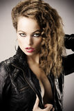 Sexy girl with leather jacket Stock Images