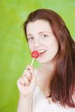 girl licking lollipop Stock Photography