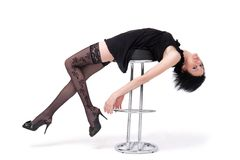 Sexy girl lies on a chair Royalty Free Stock Photos