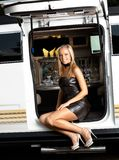 Sexy girl with limousine in leather outfit Stock Photos