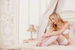 Sexy girl in lingerie in the bed Royalty Free Stock Photos