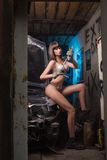 Sexy girl in lingerie car repairs Royalty Free Stock Images