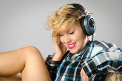 Sexy girl listening to music Stock Photos