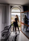 girl with long hair posing in hotel stock photography