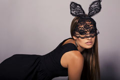 Sexy girl with long hair in elegant dress wearing bunny mask Royalty Free Stock Photos