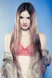 Sexy girl with long hair in red bra and fur coat Royalty Free Stock Photos