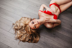 Sexy girl with long hair in red lingerie Royalty Free Stock Images