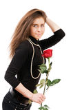 Sexy girl in love holding a red rose Royalty Free Stock Photo