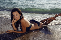 Sexy girl lying on the beach. Crimea. Royalty Free Stock Images