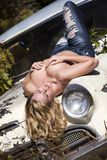 A sexy girl lying on an old car Stock Photography