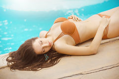 Sexy girl lying at a pool Royalty Free Stock Photography