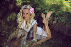 Sexy girl lying in river of Crimea. Stock Photography