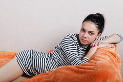Sexy girl lying on the sofa orange Stock Photography