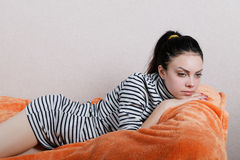 Sexy girl lying on the sofa Stock Photo