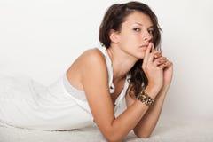 Sexy girl lying in white lingerie Stock Image
