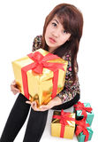 Sexy girl with many gifts Stock Photography