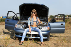 Sexy girl-mechanic near the car Royalty Free Stock Photography