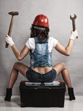 Sexy girl mechanic working with tools. Back. Royalty Free Stock Photos