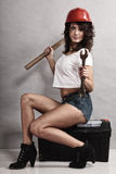 Sexy girl mechanic working with tools. Stock Images