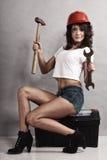 Sexy girl mechanic working with tools. Stock Image