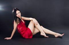Sexy girl in mini dress. Sexy leggy girl in a mini dress Stock Photo