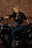 Sexy girl on motorbike Stock Photography