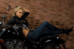 Sexy girl on motorbike Stock Photos
