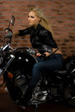 Sexy girl on motorbike Royalty Free Stock Image