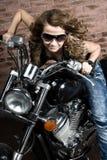 Sexy girl on motorbike Royalty Free Stock Image
