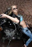Sexy girl on motorbike Stock Image
