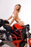 Sexy girl on motorbike Stock Image
