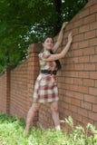 Sexy girl near brick wall Stock Photography