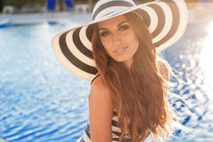 Sexy girl is near swimming pool wearing stripped Stock Photography