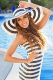 Sexy girl is near swimming pool wearing stripped Royalty Free Stock Photography