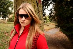 Sexy girl outdoors. Model wearing red ski jacket outdoors Royalty Free Stock Photography