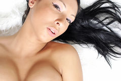 Sexy girl over white fur Stock Image