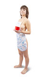 Sexy girl in  overalls with tea cup over white Stock Photography