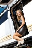 Sexy girl in party outfit in limousine door Royalty Free Stock Photography
