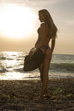 girl with perfect body posing on sunset beach Royalty Free Stock Images