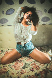 Sexy girl photo in a jeans at home Royalty Free Stock Photos