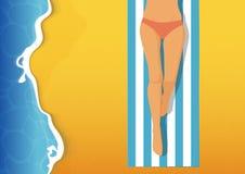 Sexy girl with pink bikini sunbathing on beach. Summer vacation. Royalty Free Stock Photography