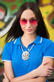 Sexy girl in pink glasses and a necklace Stock Photo