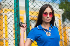 Sexy girl in pink glasses and a necklace Stock Images