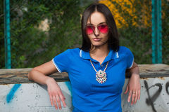 Sexy girl in pink glasses and a necklace Royalty Free Stock Images