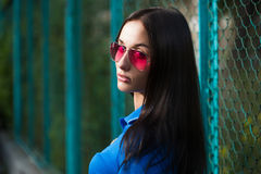 Sexy girl in pink glasses and a necklace Stock Photos