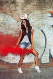 Sexy girl in pink rabbit ears dancing  with red smoke bombs Stock Photography
